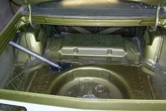 Cut in the paint around the trunk lid area and shot the spare tire area