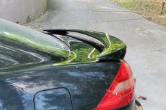 You can see the mirror reflection in both the trunk lid and spoiler