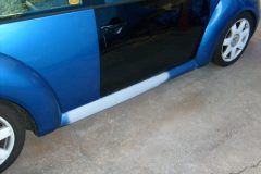 1999 Beatle with replaced door and rocker panel repair where it was crushed